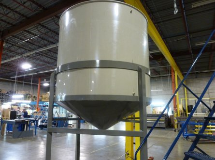 Cylindrical vertical cone bottom tank